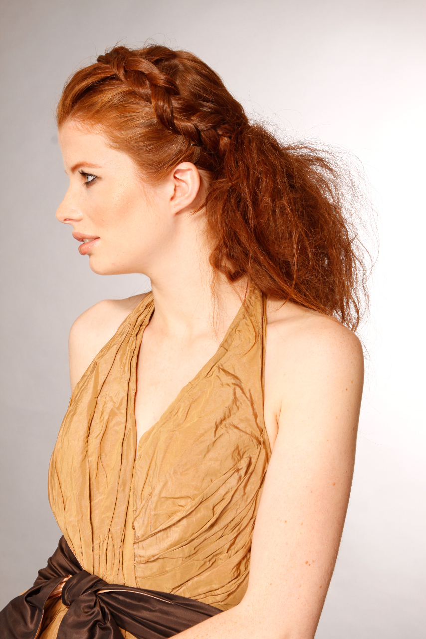 Woman with a wide, red hair braid