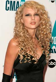 Taylor shows off a spiral curl at 17