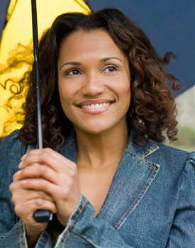 Curly haired woman holding an umbrella