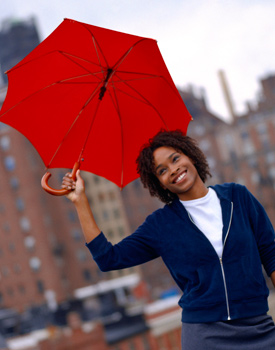 Woman with short curly hair and an umbrella