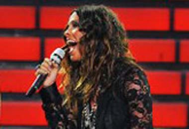Alanis Rocks Her Waves