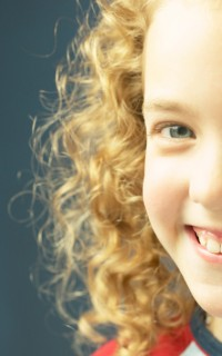 Girl with curly blonde hair