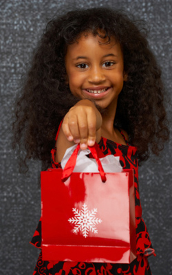 Curly girl holding bag