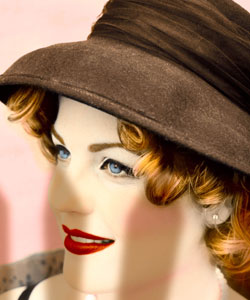 Woman wears vintage hat