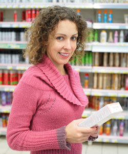 Curly haired woman in the shampoo aisle