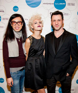 Stephen Wang and Mark Mileti with a blonde model at Texture on the Runway