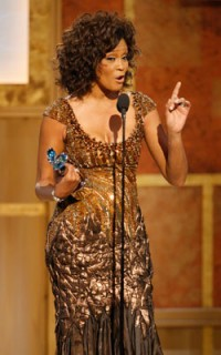 Whitney and her BET Honors for Entertainment award in 2010