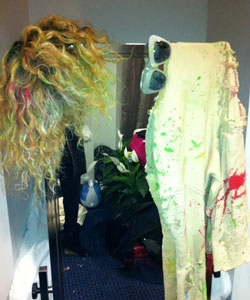 Rihanna's wig hanging on her backstage mirror