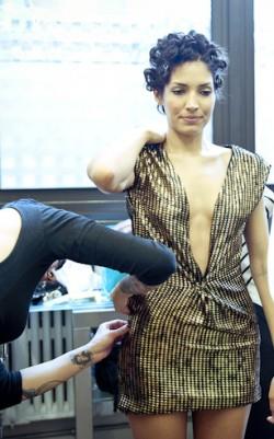 An ARROJO model gets pinned into wardrobe.