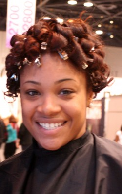 A model makes her way across the floor with her pincurl set