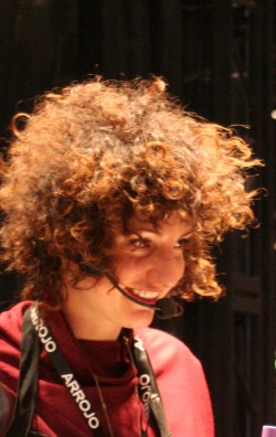 ARROJO stylist Abbey's curls in a loose, face-framing cut