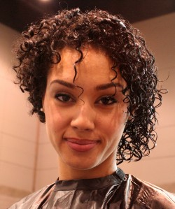 Woman with half moisturized curls.