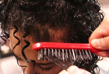 Curly Hair Solution's Root Brush works through model's curls