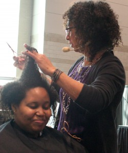 Jane Carter giving Samantha a big chop live at the Texture Pavillion