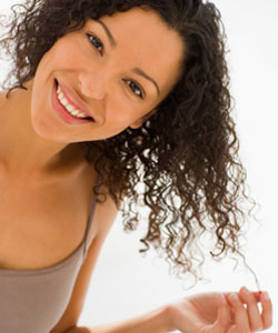 curly hair lady smiling