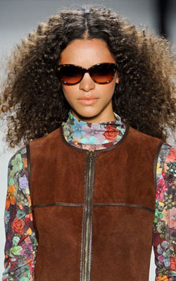 Nicole Miller shows off bold prints and bright colors with textured hair!