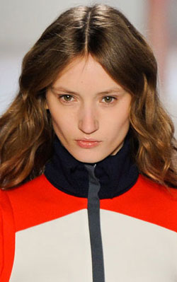 A sweeping, auburn 'do flows from this Lacoste model