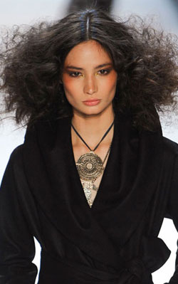 Mara Hoffman model defies the fall weather with a wide and wild mane