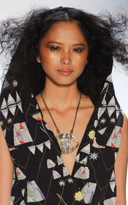 A well placed touch of frizz adds style to this Mara Hoffman model