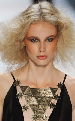 Mara Hoffman model with a feathery, golden halo of waves