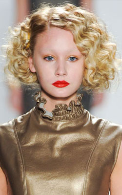 An elegant and golden glam look from Ruffian