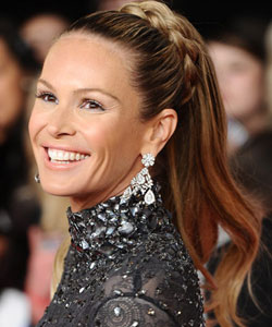 Elle Macpherson wearing a long ponytail with a broad plaited base