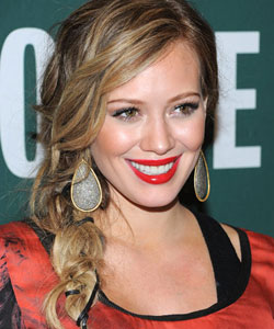 Hilary Duff wearing a plaited side braid