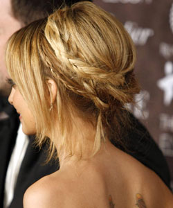 Nicole Richie with a wrap around braid