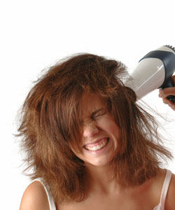 Woman suffering heat damage from blow drying