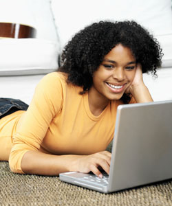 Curly haired woman on laptop