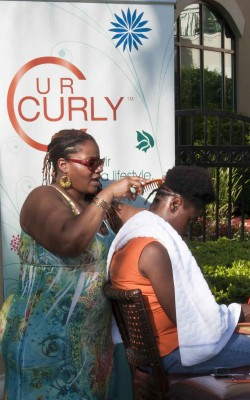 UR Curly stylist at the 2012 Curly Pool Party