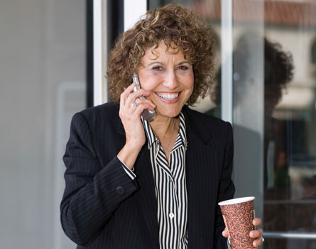 Mature lady in a suit talking on a cellphone