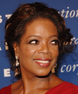 Oprah with a curly updo