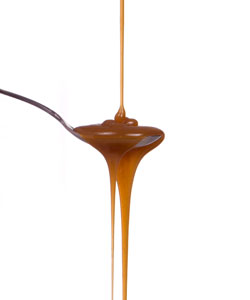 caramel dripping into and out of a spoon