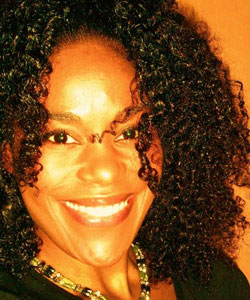 Lady with curly hair smiling