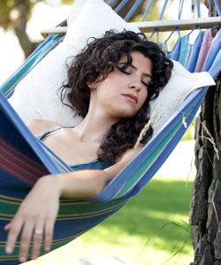 lady with Curly hair asleep in hammock