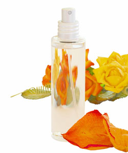 spray bottle with orange and yellow flowers