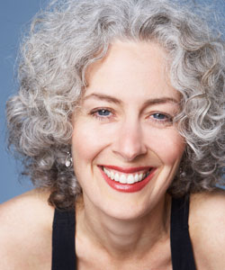 beautiful lady smiling with lovely gray curly hair