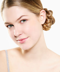 lady with blonde hair up in a side bun