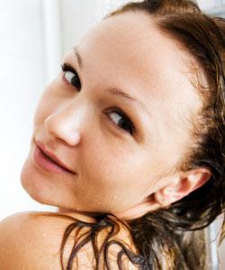 Girl rinsing her hair