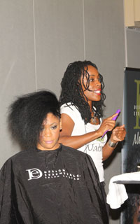 Deshonica Kerrie of Design Essentials styling natural curly hair model