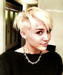 Miley Cyrus smiles with new undershave haircut