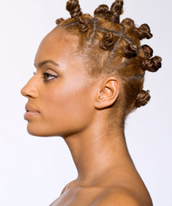 lady in profile with mini buns in her hair
