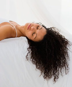 Lady with curly brown hair sleeping