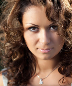 Lady with curly hair staring