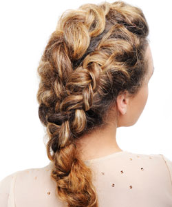 young lady with her back turned showing her curly braided hairstyle