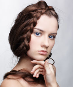 young lady with hair in a wrap around braid