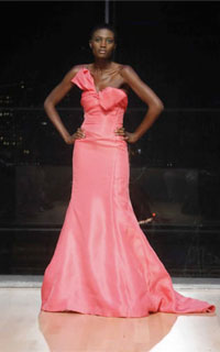 Model in pink evening gown from Harlem's Fashion Row