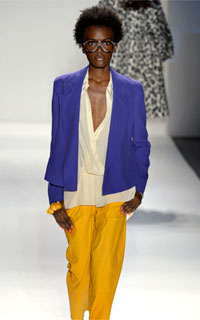 Model with coily afro in brightly-colored Tracy Reese outfit