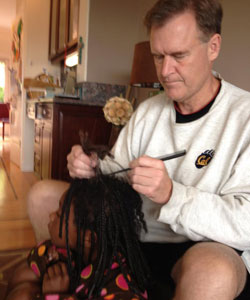 Frank Somerville removing his daughter's braids